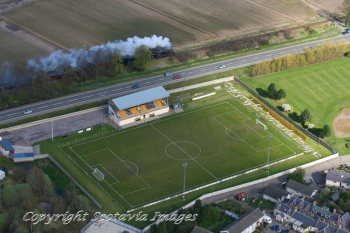 Aerial photography Scotland Forres football stadium and steam train